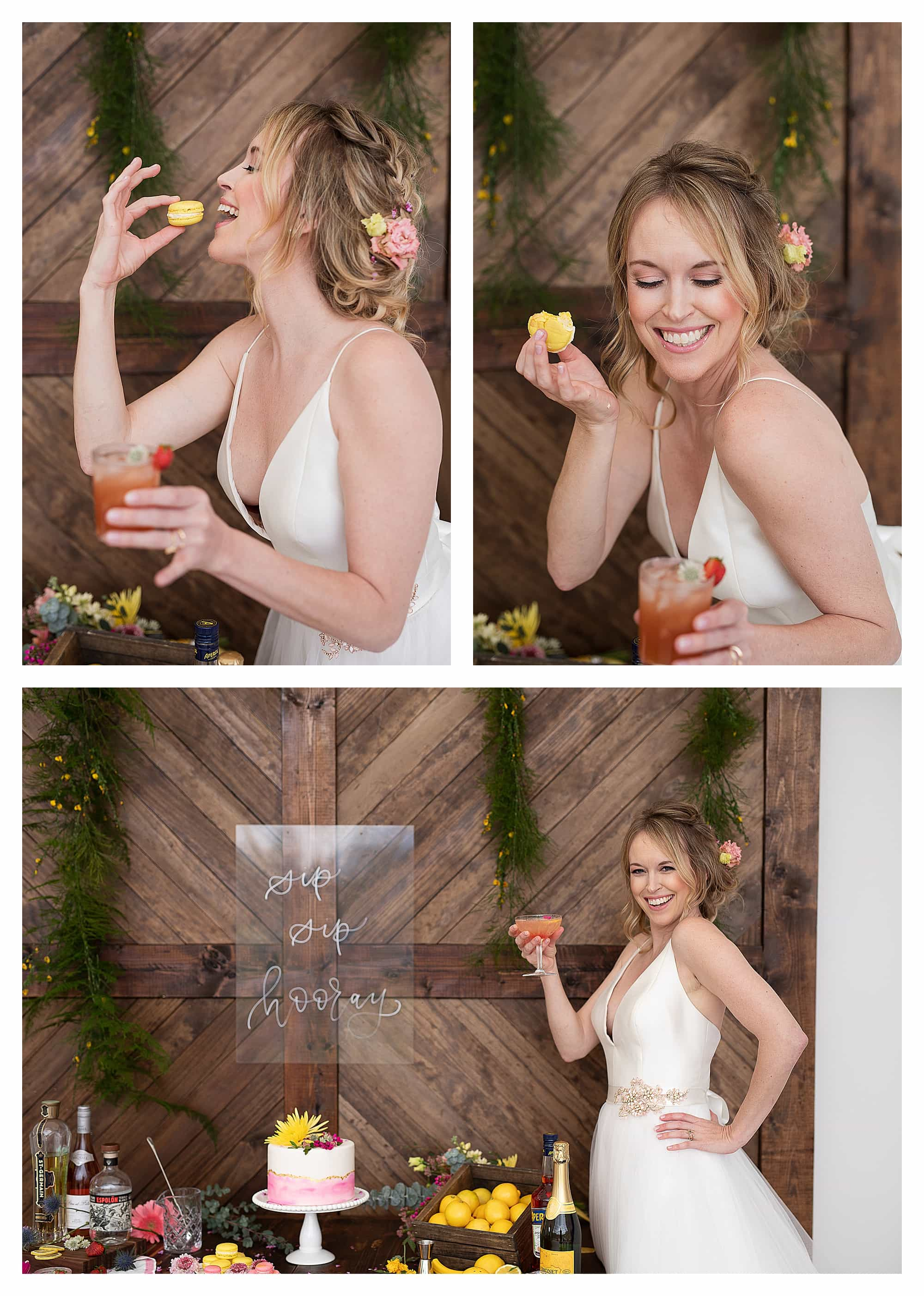 Bride in wedding dress laughing while drinking cocktail and eating yellow macarons beside beautiful wedding cake