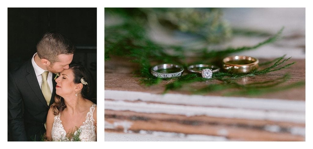 Groom kissing brides forehead and close up of weddings rings laying on greenery on top of table - kathy beaver photography