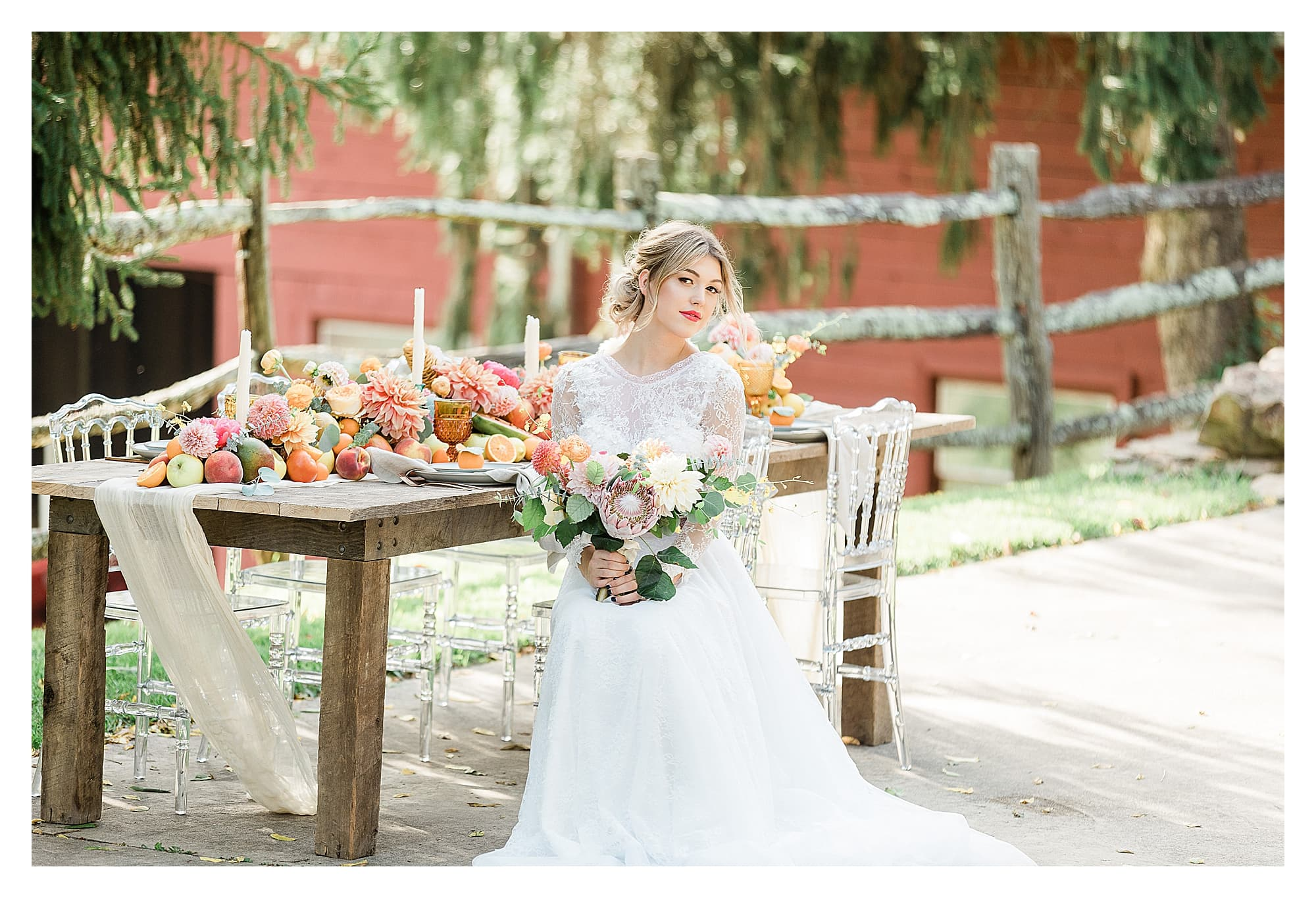Bride wearing two piece white lace wedding dress holding peach, pink and yellow themed wedding bouquet