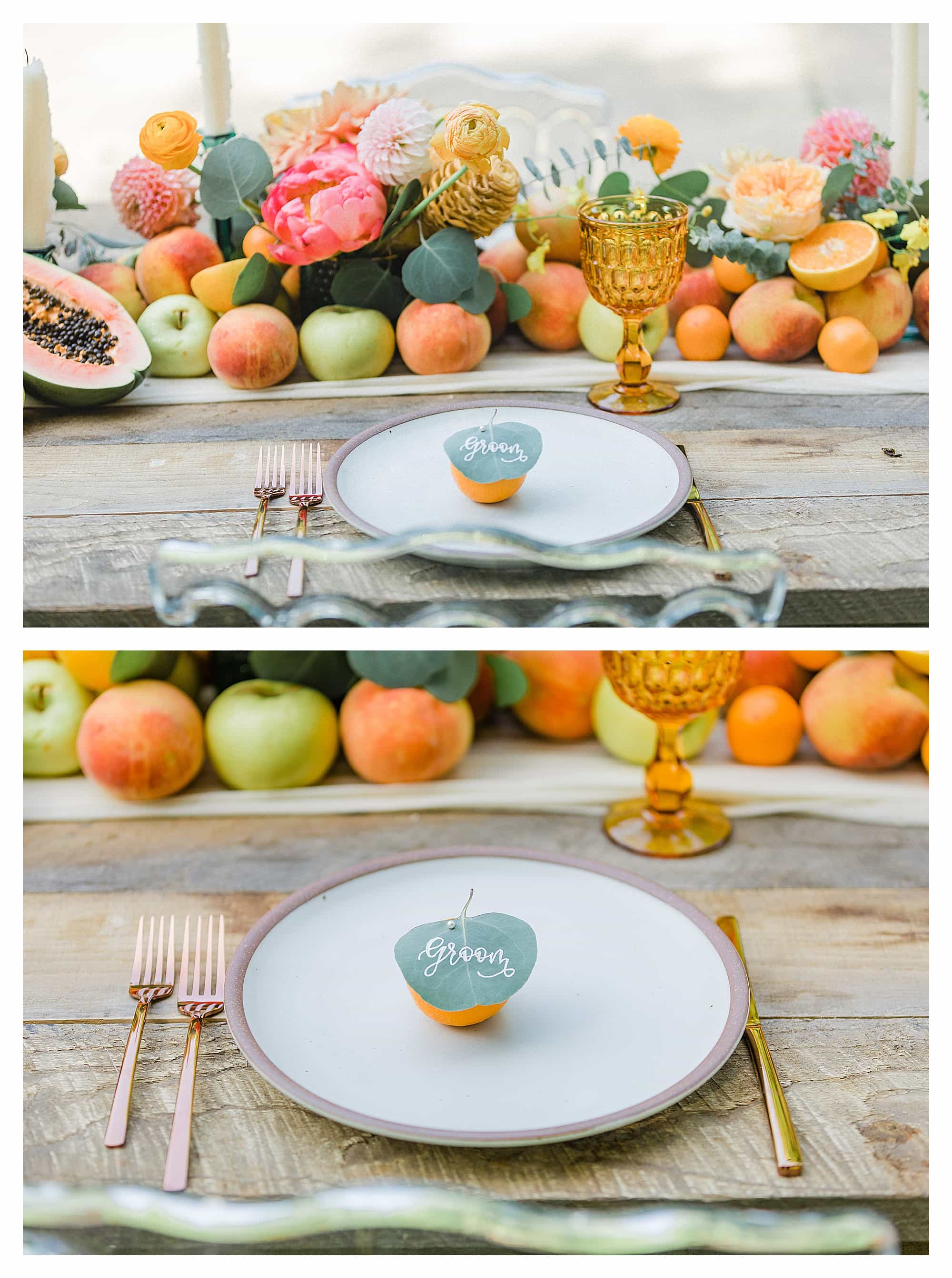 small orange with leaf pinned in it for place cards sitting on white place