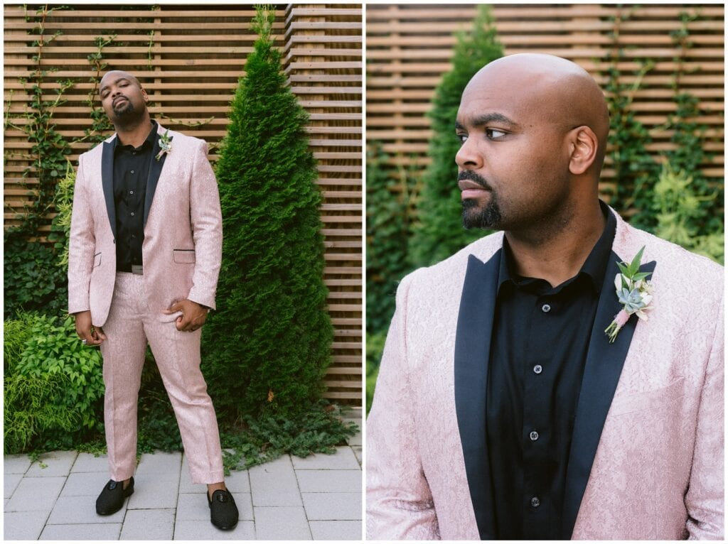 The groom wore a blush colored suit with a black shirt, and a spring floral bout for his wedding.