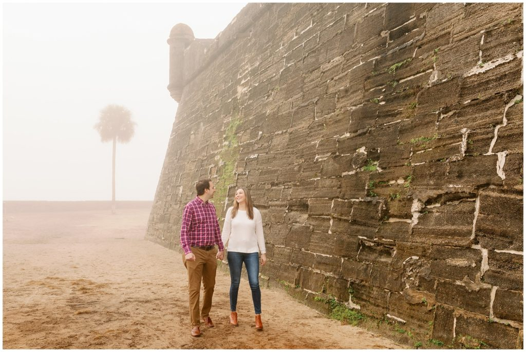 St Augustine beach engagement session in the winter with fog.