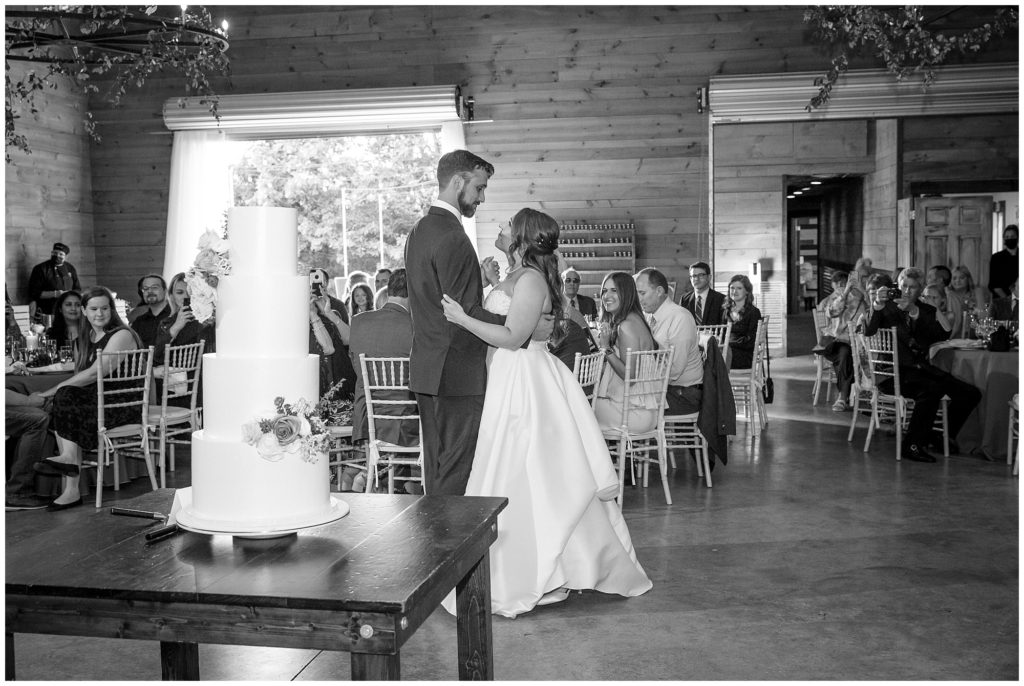 The bride and groom share a first dance together at Honeysuckle Hill after their wedding ceremony.